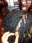 Retouching the first 2 rows of braids 4-6 weeks after installation.